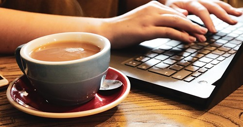 image of coffee cup and laptop